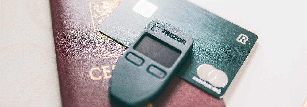 Trezor Wallet with card on the background